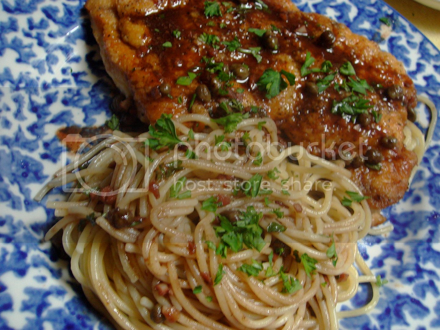 chicken cutlet with pomegranate sauce and spaghetti